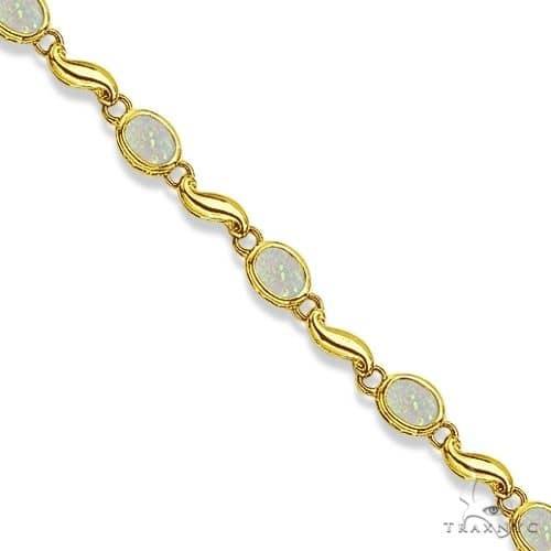 Bezel-Set Oval Opal Bracelet in 14K Yellow Gold (7x5 mm) Gemstone & Pearl