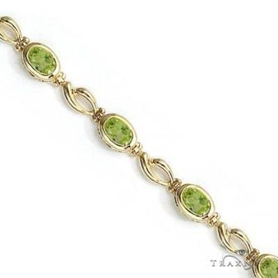 Bezel-Set Oval Peridot Link Bracelet in 14K Yellow Gold (6x4mm) Gemstone & Pearl