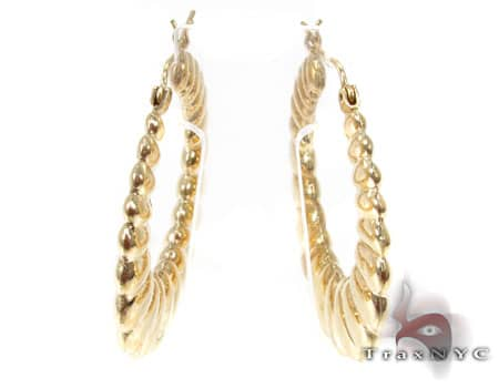 Golden Riffle Earrings Metal