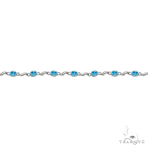 Bezel-Set Oval Blue Topaz Bracelet in 14K White Gold (7x5 mm) Gemstone & Pearl