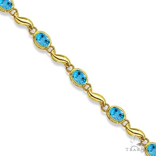 Bezel-Set Oval Blue Topaz Bracelet in 14K Yellow Gold (7x5 mm) Gemstone & Pearl