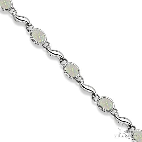 Bezel-Set Oval Opal Bracelet in 14K White Gold (7x5 mm) Gemstone & Pearl