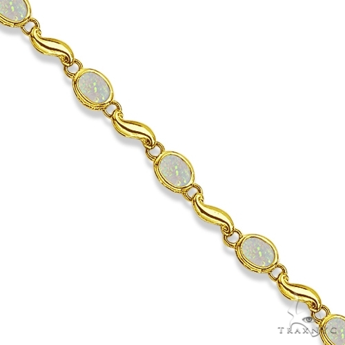 Bezel-Set Oval Opal Bracelet in 14K Yellow Gold (7x5 mm) Gemstone & Pearl